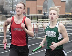 Lawrence High's Garrett Prescott and Free State's Grant Holmes run side by side in the 4x800-meter relay in the City Showdown dual meet on Tuesday at LHS.