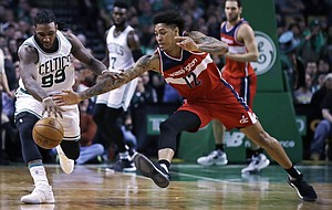 Boston Celtics forward Jae Crowder (99) and Washington Wizards forward Kelly Oubre Jr. (12) battle for a loose ball during the second half of an NBA basketball game in Boston, Monday, March 20, 2017. The Celtics defeated the Wizards 110-102. (AP Photo/Charles Krupa)