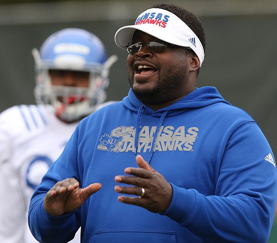 Kansas defensive line coach Jesse Williams flashes a smile during spring football practice on Thursday, March 30, 2017.