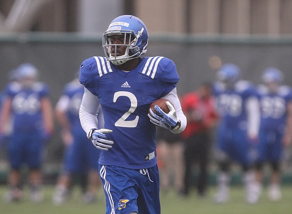 Kansas receiver Daylon Charlot runs back to the line after catching a pass during spring football practice on Thursday, March 30, 2017.