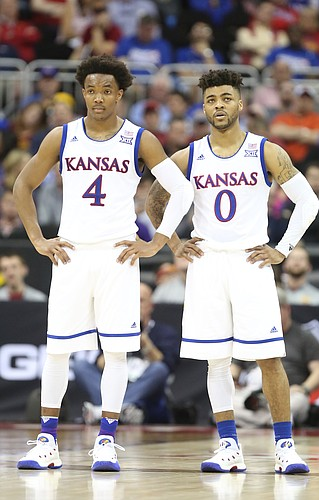 Kansas guard Devonte' Graham (4) and Kansas guard Frank Mason III stand side by side during a pair of free throws in the second half, Thursday, March 9, 2017 at Sprint Center.