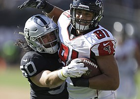 Atlanta Falcons tight end Austin Hooper (81) runs against Oakland Raiders middle linebacker Ben Heeney (50) during the second half of an NFL football game in Oakland, Calif., Sunday, Sept. 18, 2016. (AP Photo/Ben Margot)