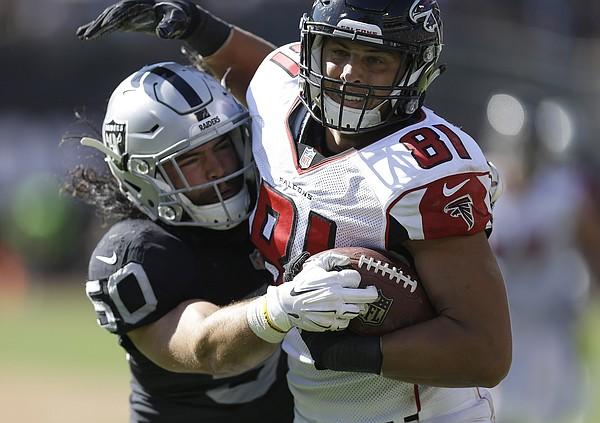 Atlanta Falcons tight end Austin Hooper (81) runs against Oakland Raiders middle linebacker Ben Heeney (50) during the second half of an NFL football game in Oakland, Calif., Sunday, Sept. 18, 2016. (AP Photo/Ben Margot)