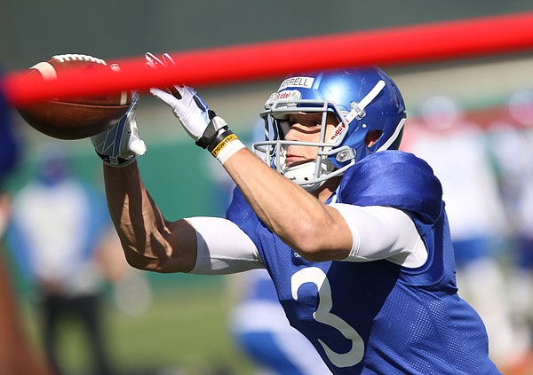 Kansas receiver Chase Harrell catches a pass over an obstacle during practice on Thursday, April 6, 2017.