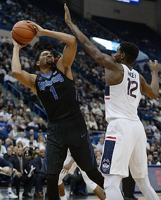 Memphis' Dedric Lawson looks to shoot as Connecticut's Kentan Facey, right, defends in the first half of an NCAA college basketball game, Thursday, Feb. 16, 2017, in Hartford, Conn. (AP Photo/Jessica Hill)