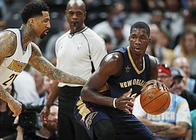 Denver Nuggets forward Wilson Chandler, left, defends against New Orleans Pelicans forward Cheick Diallo during the second half of an NBA basketball game Friday, April 7, 2017, in Denver. The Nuggets won 122-106. (AP Photo/David Zalubowski)