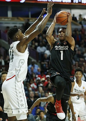 East's Trevon Duval, right, drives to the basket against West's Brandon L. McCoy during the second half of the McDonald's All- American boys high school basketball game in Chicago, Wednesday, March 29, 2017. West won 109-107.