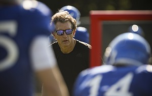 Kansas offensive coordinator Doug Meacham works with the receivers during practice on Tuesday, April 11, 2017.
