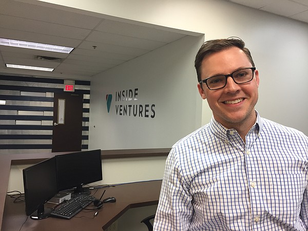 Trevor Nohe, president of Inside Ventures, stands in a training area of the company's new Downtown Lawrence facility.