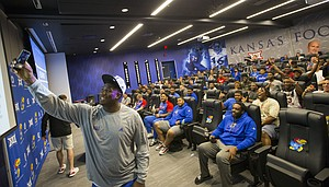 Kansas defensive tackle Daniel Wise shoots a selfie of himself and his team after being selected as the fourth-overall pick during a spring game player draft on Wednesday, April 12, 2017 at the Anderson Family Football Complex.