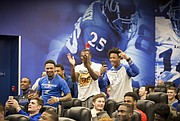 Kansas players react after quarterbacks Peyton Bender and Carter Stanley were selected to teams via pulling a name out of a hat, just before a spring game player draft on Wednesday, April 12, 2017 at the Anderson Family Football Complex.
