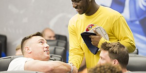 Kansas linebacker Joe Dineen congratulates junior receiver Steven Sims Jr. after Sims was selected as the first overall pick during a spring game player draft on Wednesday, April 12, 2017 at the Anderson Family Football Complex.