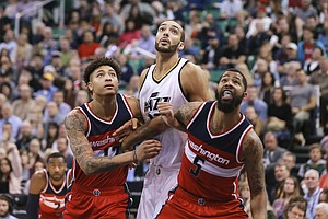 Washington Wizards forward Kelly Oubre Jr. (12) and Washington Wizards forward Markieff Morris (5) try to keep Utah Jazz center Rudy Gobert (27) from getting the rebound from a foul shot during the fourth quarter of NBA basketball game Friday, March 31, 2017, in Salt Lake City. The Utah Jazz won the game 95-88. (AP Photo/Chris Nicoll)