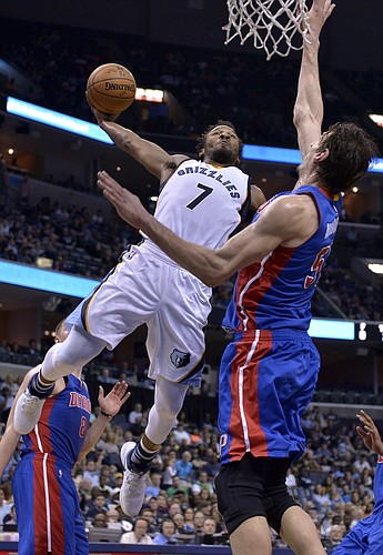 Memphis Grizzlies guard Wayne Selden (7) shoots against Detroit Pistons center Boban Marjanovic (51) in the second half of an NBA basketball game Sunday, April 9, 2017, in Memphis, Tenn. (AP Photo/Brandon Dill)