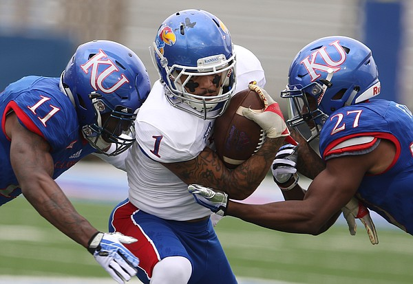Team Jayhawk wide receiver LaQuvionte Gonzalez (1) is caught between Team KU safety Mike Lee (11) and Team KU cornerback DeAnte Ford (27) during the first quarter of the 2017 Spring Game on Saturday, April 15 at Memorial Stadium.