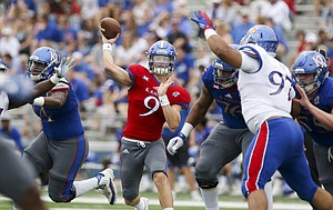 Team KU quarterback Carter Stanley (9) throws to a receiver during the first quarter of the 2017 Spring Game on Saturday, April 15 at Memorial Stadium.