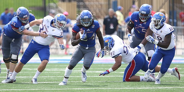 Team KU running back Taylor Martin (24) looks to make a move during the third quarter of the 2017 Spring Game on Saturday, April 15 at Memorial Stadium.