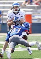 Team Jayhawk running back Ryan Schadler (33) is hit after the catch by Team KU safety Mike Lee (11) during the fourth quarter of the 2017 Spring Game on Saturday, April 15 at Memorial Stadium.