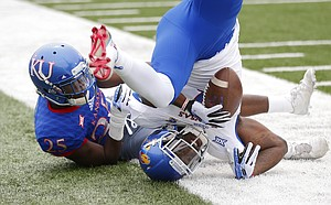 Team Jayhawks receiver Daylon Charlot rolls over out of bounds after pulling in a catch while covered by Team KU cornerback Julian Chandler (25) during the second quarter of the 2017 Spring Game on Saturday, April 15 at Memorial Stadium.