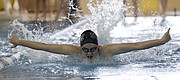 Free State High School swimmer Ava Cormaney competes in the 200-yard butterfly during a Firebirds meet against Shawnee Mission East Tuesday, April 18, 2017.