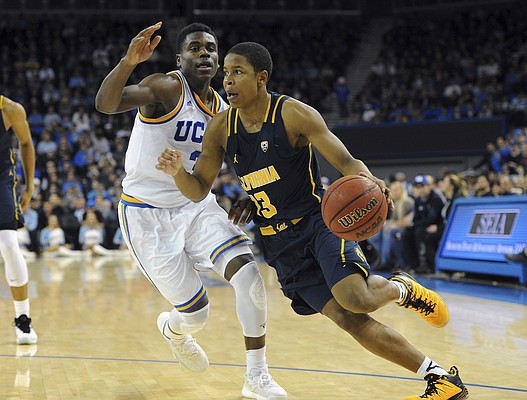 California guard Charlie Moore (13) drives against UCLA's Aaron Holiday (3) during an NCAA college basketball game in Los Angeles, Thursday, Jan. 5, 2017. (AP Photo/Michael Owen Baker)