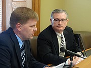 Kansas Budget Director Shawn Sullivan, left, and Legislative Research Department Director Raney Gilliland discuss the latest Consensus Revenue Estimates for Kansas during a news conference Thursday.