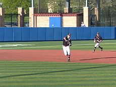Lawrence High senior third baseman Braden Solko fires a throw to first base against Lee's Summit West on Saturday at Hogland Ballpark.