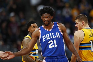 Philadelphia 76ers center Joel Embiid (21) in the first half of an NBA basketball game Friday, Dec. 30, 2016, in Denver. (AP Photo/David Zalubowski)