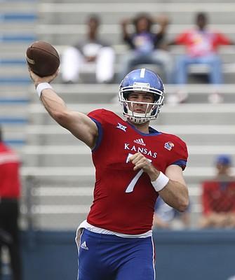 Kansas junior quarterback Peyton Bender throws during the spring game, on Saturday, April 15, at Memorial Stadium.