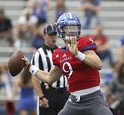 Kansas redshirt sophomore quarterback Carter Stanley pulls back to throw during the spring game, on Saturday, April 15, at Memorial Stadium.
