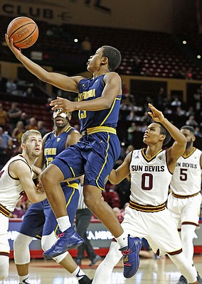 California guard Charlie Moore, left, drives past Arizona State guard Tra Holder (0) to score during the first half of an NCAA basketball game Wednesday, Feb. 8, 2017, in Tempe, Ariz.