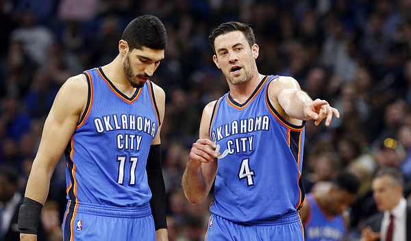 Oklahoma City Thunder's Enes Kanter, left, of Turkey, and Nick Collison confer during the second half of an NBA basketball game against the Minnesota Timberwolves Tuesday, April 11, 2017, in Minneapolis. (AP Photo/Jim Mone)