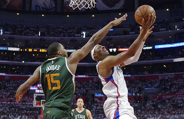 Los Angeles Clippers forward Paul Pierce, right, shoots as Utah Jazz forward Derrick Favors defends during the second half in Game 7 of an NBA basketball first-round playoff series, Sunday, April 30, 2017, in Los Angeles. The Jazz won 104-91. (AP Photo/Mark J. Terrill)
