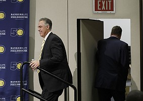 Kevin Pritchard, left, walks to the podium as Larry Bird leaves after speaking during a news conference Monday, May 1, 2017, in Indianapolis. Bird resigned from his position as Indiana Pacers president of basketball operations. Pritchard is assuming Bird's position. (AP Photo/Darron Cummings)