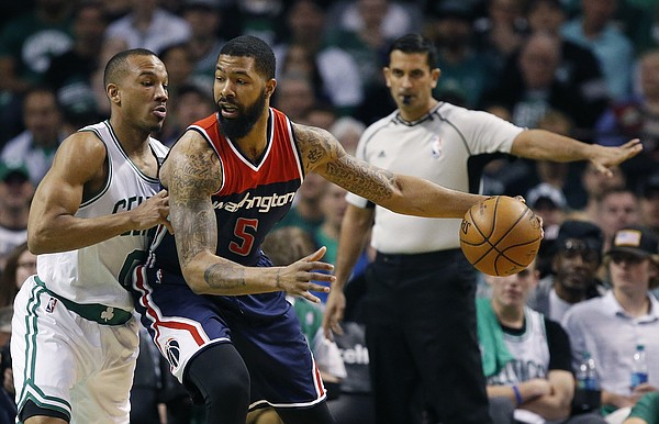 Boston Celtics' Avery Bradley (0) defends against Washington Wizards' Markieff Morris (5) during the first quarter of a second-round NBA playoff series basketball game, Sunday, April, 30, 2017, in Boston. (AP Photo/Michael Dwyer)