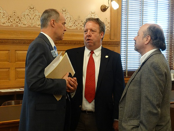 House Taxation Committee Chairman Steve Johnson, left, discusses details of the latest income tax plan with the two Democrats on the conference committee, Sen. Tom Holland, center, and Rep. Tom Sawyer.