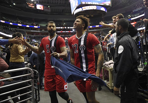 Washington Wizards' Kelly Oubre Jr. (12) and Markieff Morris (5) leave the court after the team's NBA basketball game against the Boston Celtics, Tuesday, Jan. 24, 2017, in Washington. The Wizards won 123-108. (AP Photo/Nick Wass)