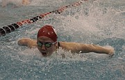 Lawrence High sophomore Emily Guo swims the butterfly leg of the Lions' 200-yard medley relay at the Sunflower League meet on Saturday at California Trail Middle School.