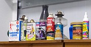 A shelf at the Lawrence-Douglas County Household Hazardous Waste Center is stocked with some of the products from years past that employees set aside because of age.