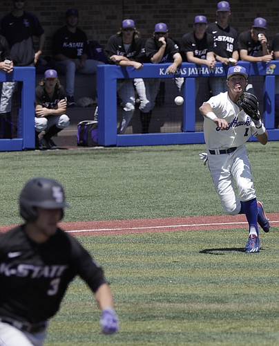 After fielding a bunt down the third base line, Kansas infielder Benjamin Sems throws to first base for an out during the Jayhawks game Saturday, May 13 against the Kansas State Wildcats.