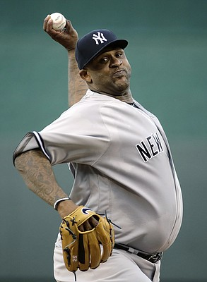 New York Yankees pitcher C.C. Sabathia delivers a pitch against the Kansas City Royals.