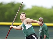 Free State's Nathan Spain motions to throw on his first attempt during the 6A Regionals on Thursday, May 18, 2017 at Free State High School.