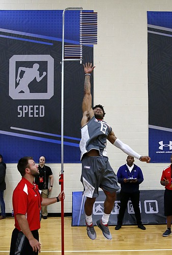 Kansas' Frank Mason III participates in the standing vertical jump at the NBA basketball draft combine Thursday, May 11, 2017, in Chicago. (AP Photo/Charles Rex Arbogast)