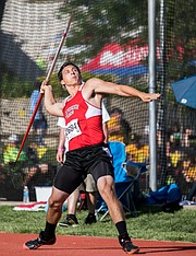 Lawrence High's Hunter Krom throws the javelin in the Class 6A Track and Field State Championship meet on Friday afternoon in Cessna Stadium. Krom finished second with a throw of 204 feet two inches. Krom was only eight inches behind the leader.