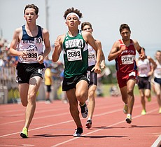 Free State's Avant Edwards (2693) runs the 1600 meter run at the Track and Field State Championship meet on Saturday afternoon in Cessna Stadium. Edwards placed sixth in the Class 6A 1600 meter run with a time of 4:31.