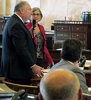 Kansas Senate Majority Leader Jim Denning, left, R-Overland Park, speaks against an amendment to concealed carry legislation offered by Senate President Susan Wagle, right, R-Wichita, during a debate, Thursday, June 1, 2017, at the Statehouse in Topeka, Kan. Wagle's amendment has the backing of the National Rifle Association and narrows a bill aimed at keeping concealed weapons out of public hospitals. (AP Photo/John Hanna)