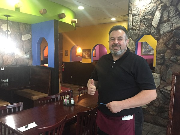 Owner Jose Pepe Lopez in the dining room of Acapulco Mexican Restaurant in west Lawrence.