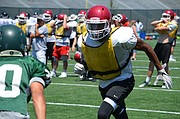 Eudora junior receiver Ronnie Ford prepares to block a Free State defensive back at the University of Kansas football team camp at Memorial Stadium on June 5, 2017