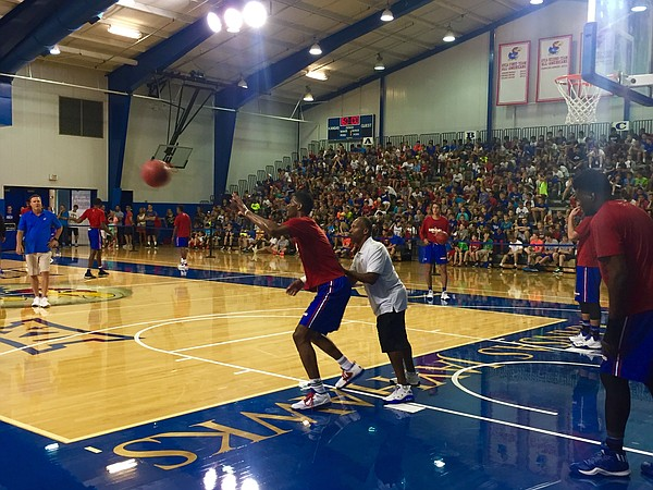 KU freshman Billy Preston works a drill with assistant coach Norm Roberts during Tuesday's workout.