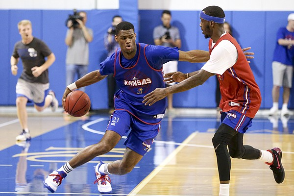 Blue Team forward Billy Preston goes behind the back as he makes a move against Red Team guard Tyshawn Taylor during a scrimmage on Wednesday, June 7, 2017 at the Horejsi Family Athletics Center.